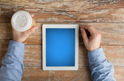 Close up of male hands with tablet pc and coffee Royalty Free Stock Photos