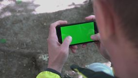 Close-up of male hands touching of smartphone. Green screen Chroma Key. Close up. Tracking motion stock video footage