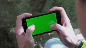 Close-up of male hands touching of smartphone. Green screen Chroma Key. Close up. Tracking motion.  stock video