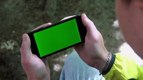 Close-up of male hands touching of smartphone. Green screen Chroma Key. Close up. Tracking motion stock footage