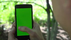 Close-up of male hands touching of smartphone. Green screen Chroma Key. Close up. Tracking motion.  stock video footage