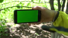 Close-up of male hands touching of smartphone. Green screen Chroma Key. Close up. Tracking motion stock video