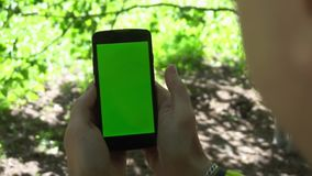 Close-up of male hands touching of smartphone. Green screen Chroma Key. Close up. Tracking motion.  stock footage