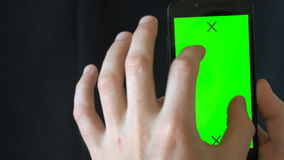 Close-up of male hands touching of smartphone. Green screen Chroma Key. Close up. Tracking motion. Vertical. pants. - stock footage