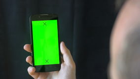 Close-up of male hands touching of smartphone. Green screen Chroma Key. Close up. Tracking motion. Vertical. pants. -. Swipe left right animation black 6 stock footage