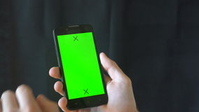 Close-up of male hands touching of smartphone. Green screen Chroma Key. Close up. Tracking motion. Vertical. pants. - stock video footage
