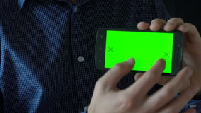 Close-up of male hands touching of smartphone. Green screen Chroma Key. Close up. Tracking motion. Vertical. pants. -. Swipe left right animation black 6 stock video