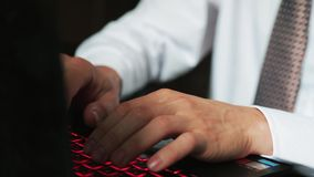 Close up of male hands types on a laptop. Businessman working on an office. slow motion. 3840x2160 stock video footage