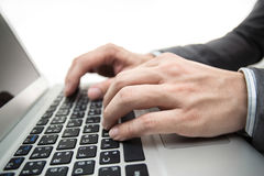 Close-up of male hands typing on laptop Royalty Free Stock Image