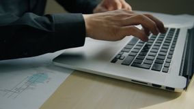 Close up of male hands typing text on laptop keyboard. Concept of: business people, laptop on desk, office table, keyboard button, hand typing keyboard stock video