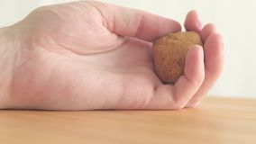 Close-up - male hands of an unidentified hungry male patient drops a muffin stock footage