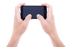 Close up of male hands using mobile smart phone with blank scree Royalty Free Stock Photos