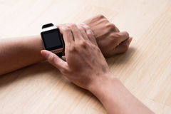 Close up of a male hands using a modern smart watch. Close up of a male hands using a modern smart watch Royalty Free Stock Photo
