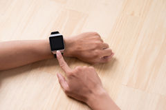 Close up of a male hands using a modern smart watch. Royalty Free Stock Photography