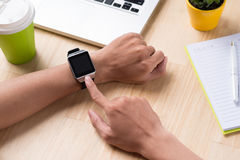Close up of a male hands using a modern smart watch. Royalty Free Stock Photos