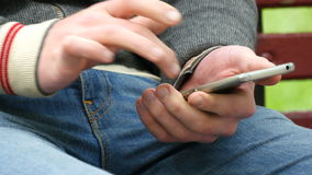 Close-up of male hands using smartphone outdoor stock video footage