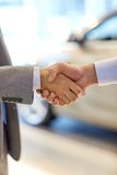 Close up of male handshake in auto show or salon Stock Photo