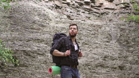 Close-up of male hiker with backpack in mountains. stock footage
