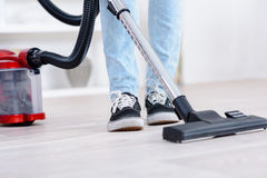 Close up male hoovering carpet Stock Photo