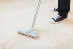 Close up of male hoovering carpet Royalty Free Stock Photos