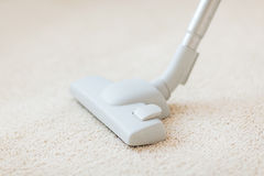 Close up of male hoovering carpet Stock Photography