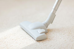 Close up of male hoovering carpet Stock Photos