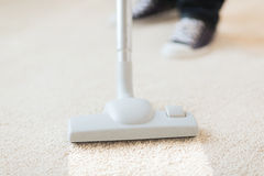 Close up of male hoovering carpet Stock Image