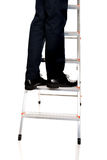 Close up male legs climbing ladder Royalty Free Stock Photos