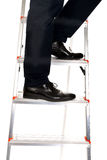 Close up male legs climbing ladder Royalty Free Stock Images