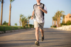 Close up of male legs running Stock Photo
