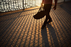 Close up male legs walking on sunset Royalty Free Stock Photo