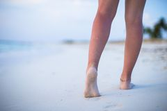 Close up of male legs on white sandy beach Royalty Free Stock Images