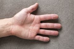 Close-up of male masculine hand with rough skin and short fingernails resting on flat copy space background, top view. Manual. Labor and hands care concept stock photos