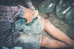 Close-up of a male mechanic with glass polish machine. Bali island Royalty Free Stock Images