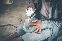 Close-up of a male mechanic with glass polish machine. Bali island Stock Photography