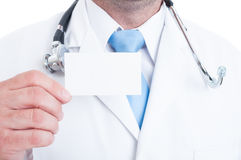 Close-up of male medic holding blank business card Royalty Free Stock Photo