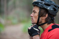 Close-up of male mountain biker wearing bicycle helmet Stock Photos