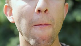 Close-up of male mouth eating ice cream stock footage