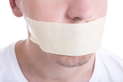 Close up of male mouth with tape isolated on white. Background stock photos