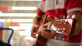 Close up of a male musician in jeans playing stock video footage
