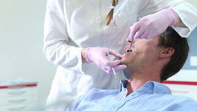 Close up of male patient showing aching tooth to dentist stock footage