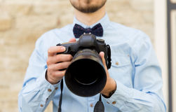 Close up of male photographer with digital camera Royalty Free Stock Photography