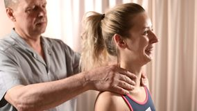 Close-up of male physiotherapist hands doing wellness massage to a young girl patient. Osteopathy and non traditional