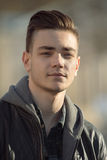 Close-up male portrait outdoor in city with blur buildings Royalty Free Stock Photos