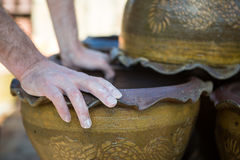Close-up of male potter checking pot Royalty Free Stock Image
