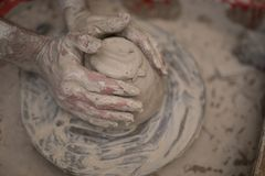 Male potter molding a clay. Close-up of male potter molding a clay in pottery workshop Royalty Free Stock Photography