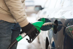 Close up of male refilling car fuel tank Stock Images