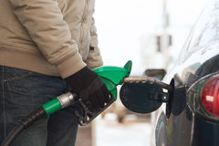 Close up of male refilling car fuel tank Royalty Free Stock Image