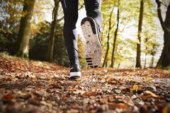 Close Up Of Male Runners Feet On Run Through Autumn Landscape Stock Image