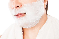 Close up of male shaving isolated over white. Background Stock Image